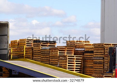 Loading ramp and stack of pallets - stock photo