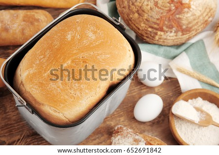 Loaf Baked In Bread Machine On Wooden Table
