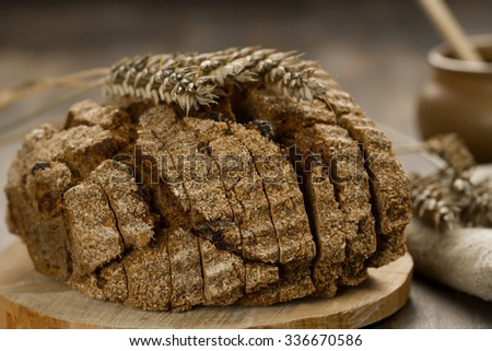 Loaf freshly baked traditional bread on  wooden table
