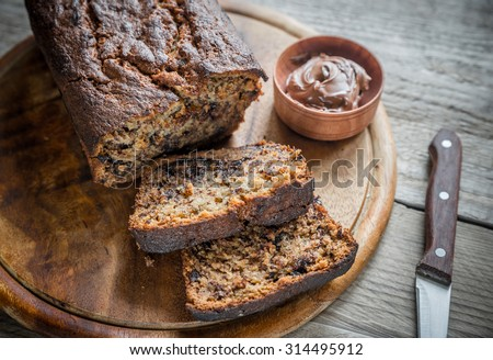Loaf of banana-chocolate bread with chocolate cream - stock photo