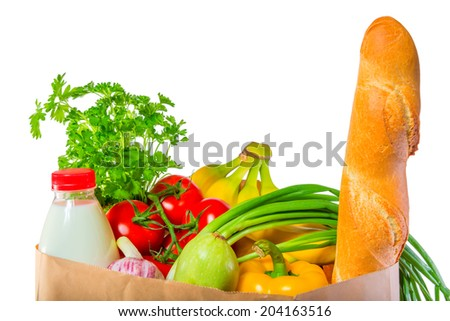 loaf of bread, milk and vegetables in the package on white background - stock photo
