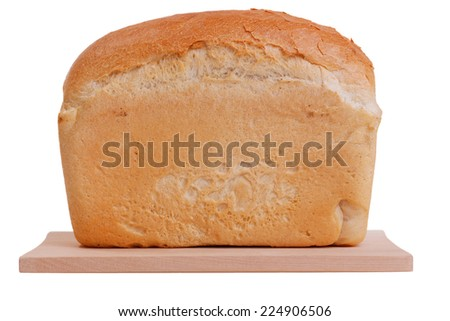 loaf of bread on cutting board isolated on white background loaf of bread on cutting board isolated on white background - stock photo