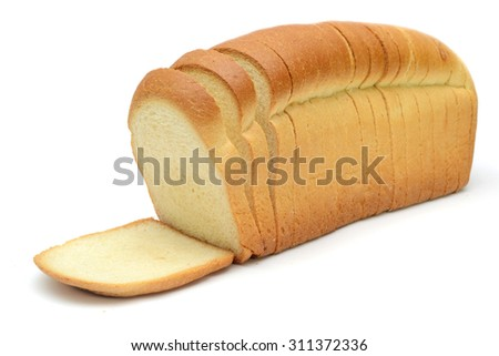 loaf of bread sliced on white background - stock photo