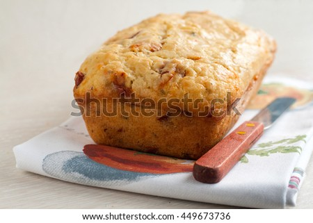 Loaf of bread with cheese and tomato