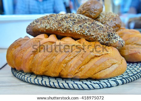Loaf of white and brown bread on a white pedestal. - stock photo