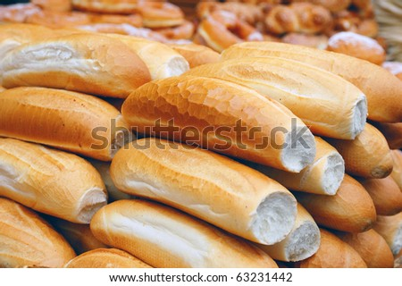 loafs of bread on market stand - stock photo