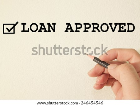 loan approved check mark on wall background  - stock photo