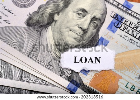 Loan concept with dollar note and paper on foreground - stock photo