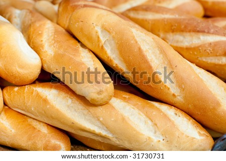 Loaves of French baguettes found along Vietnam streetside stalls. - stock photo