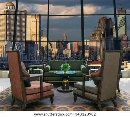 Lobby area of a hotel which can see cityscape at evening time - stock photo