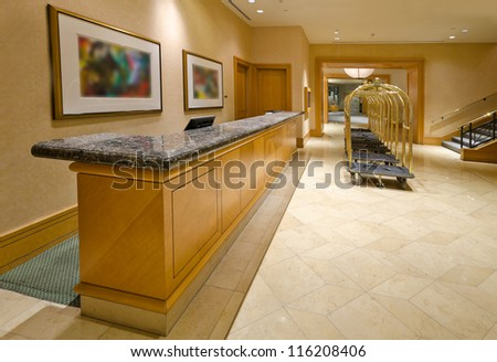 Lobby of the luxury five stars hotel with the luggage carts and the counter. Vancouver, Canada. - stock photo