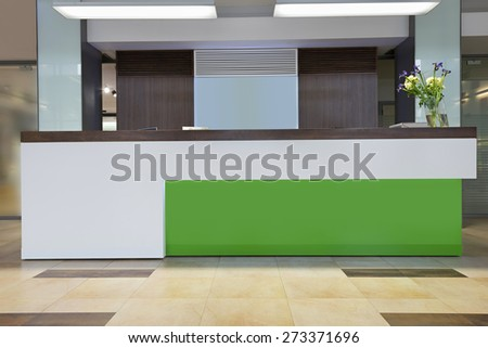 Lobby with reception desk - stock photo