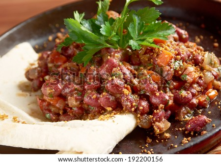 Lobio a family of dish��µs of prepared beans , containing coriander, walnuts, garlic and onion, popular i cuisines of the South Caucasus nation of Georgia. - stock photo