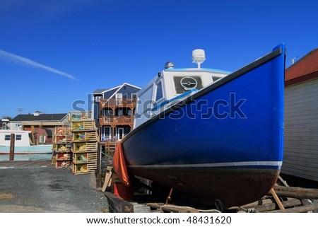 Lobster boat under repair - stock photo