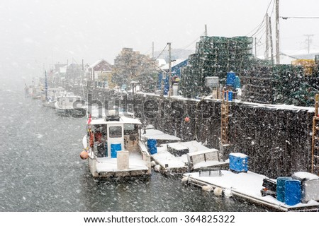 Lobster boats in Portland, Maine harbor during a blizzard - stock photo