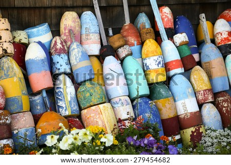 Lobster buoys as decoration of a lobster shed - stock photo
