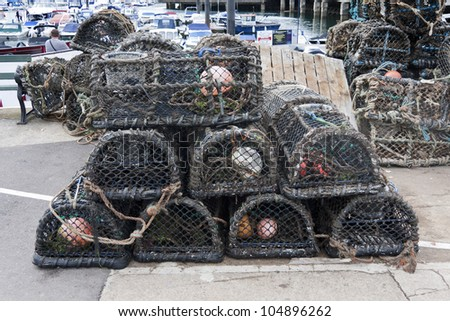 Lobster pots on the harbourside at Torquay, England, UK.