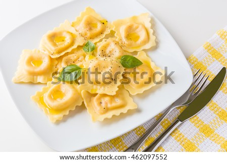 Lobster ravioli with olive oil and black pepper.