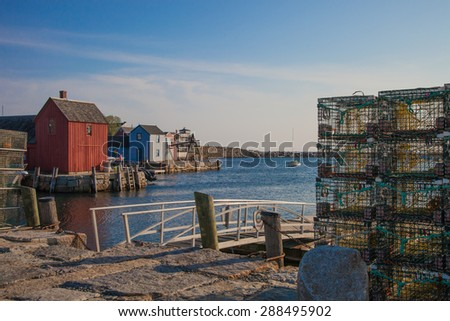 Lobster traps stacked in Rockport, MA, a quaint fishing village located along the northern coast of Massachusetts - stock photo