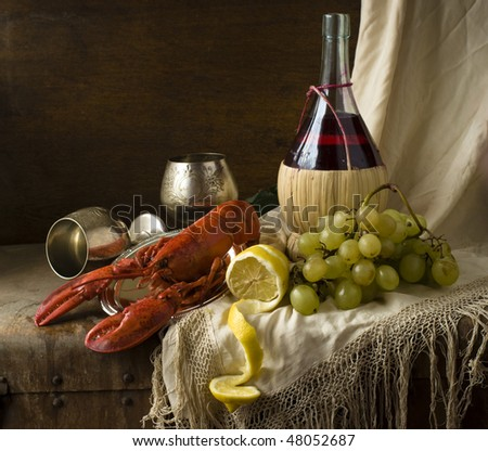 lobster with grapes and silver goblets and wine - stock photo