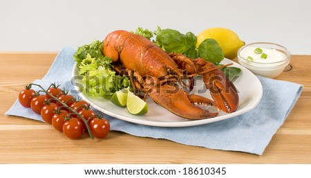 Lobster with vegetable garnish - stock photo