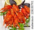 Lobsters on a plate with parsley, basil and lemon. - stock photo