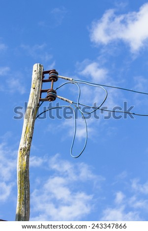 Local Electrical Wooden Pole with blue sky