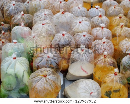 Local food, curry in plastic bag, Thailand. - stock photo
