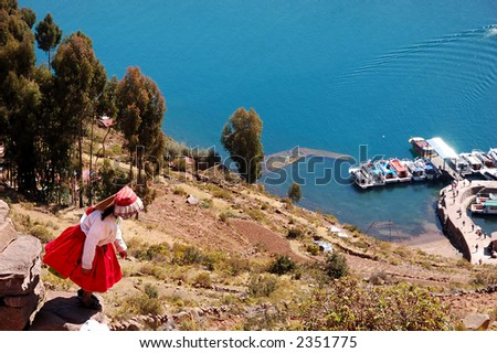 Local girl on Tequile Island climbing down the stairs to the boat dock - stock photo