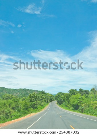 Local highway under blue sky - stock photo