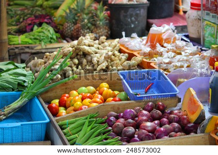 Local market with fruits and vegetables in Asia - stock photo