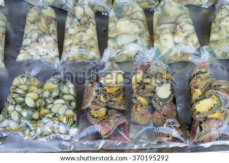 Local seafood. Raw mollusk in shells on the market. - stock photo
