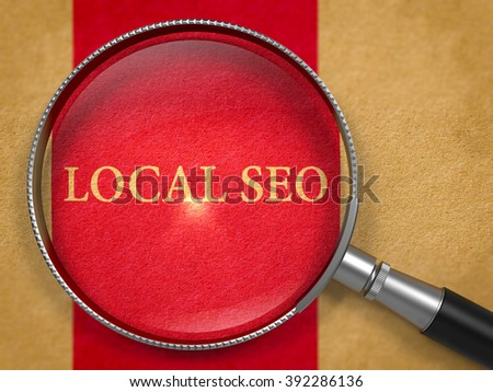 Local SEO - Search Engine Optimization - Concept through Magnifier on Old Paper with Dark Red Vertical Line Background. 3D Render. - stock photo