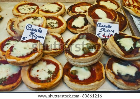 Local small pizzas with green and black olives called Mignom and Sfoglia - stock photo