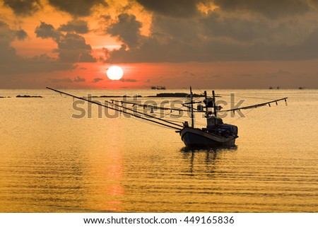 Local Thai fishing boat on sea - stock photo