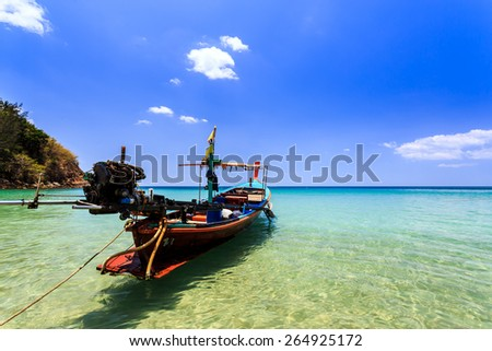 Local Traditional boat at Banana Beach, Phuket, Thailand - stock photo