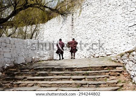 Locals at Rinpung Dzong - Paro - Bhutan - stock photo