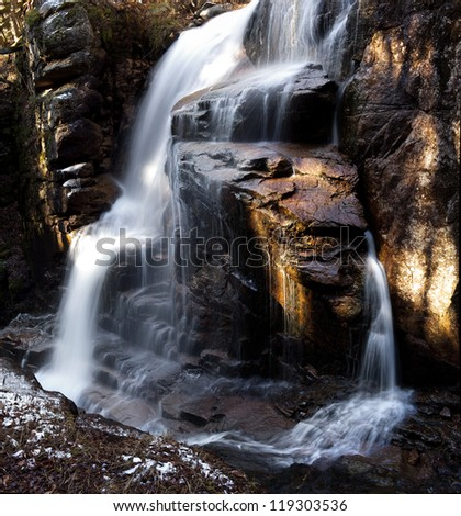 Located at Flume Gorge, Lincoln NH  Waterfall is aove the gorge itself. - stock photo