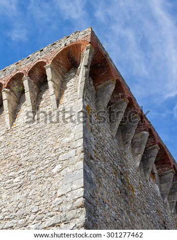Located in Portugal, and constructed during the 13th century, the corner is from a castle located in the town of Ourem.  - stock photo