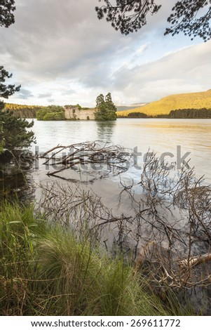 Loch an Eilein Castle in Scotland. - stock photo
