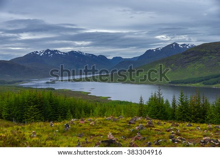 Loch Cluanie, Scotland lake and mountain landscape