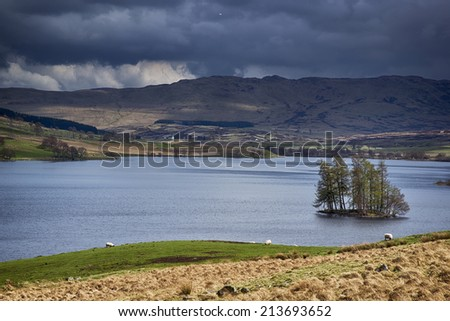 Loch Freuchie and The Crannog, looking across to Creag Bheag and Craig Hulich. Glen Quaich, is across the other side of the Loch and The Rob Roy Way, run either side of the Loch. Perthshire, Scotland.