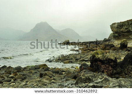 Loch Scavaig and misty mountains in the Scottish Highlands - stock photo