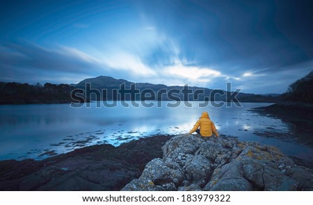 Loch Sunart, Scottish Highlands UK. A traveller finds time for a moments peace, reflecting on the trip so far and the ultimate sadness of it nearing an end. - stock photo