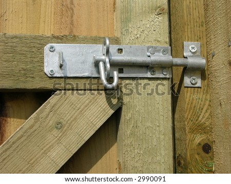 Lock and Bolt on a wooden fence - stock photo
