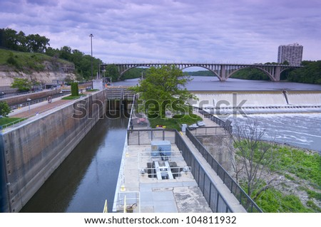 Lock and Dam One on Mississippi River in Minneapolis and Ford Parkway bridge in background - stock photo