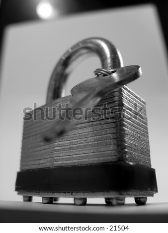 Lock and key lite by spotlight - stock photo