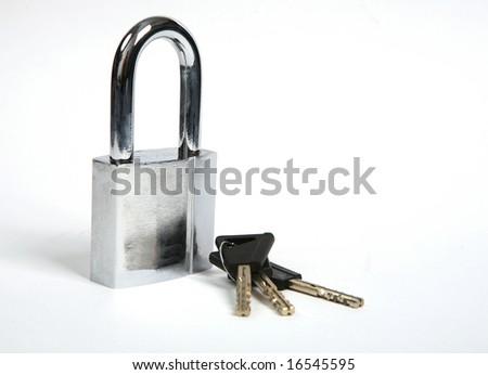 Lock and keys on white background. - stock photo