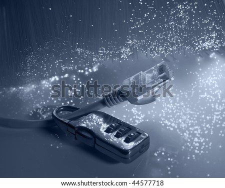 Lock and network cable with fiber optical background - stock photo