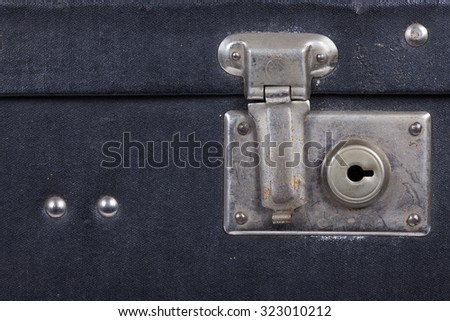 Lock of an old black suitcase - stock photo